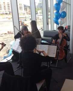 string ensemble playing at the library
